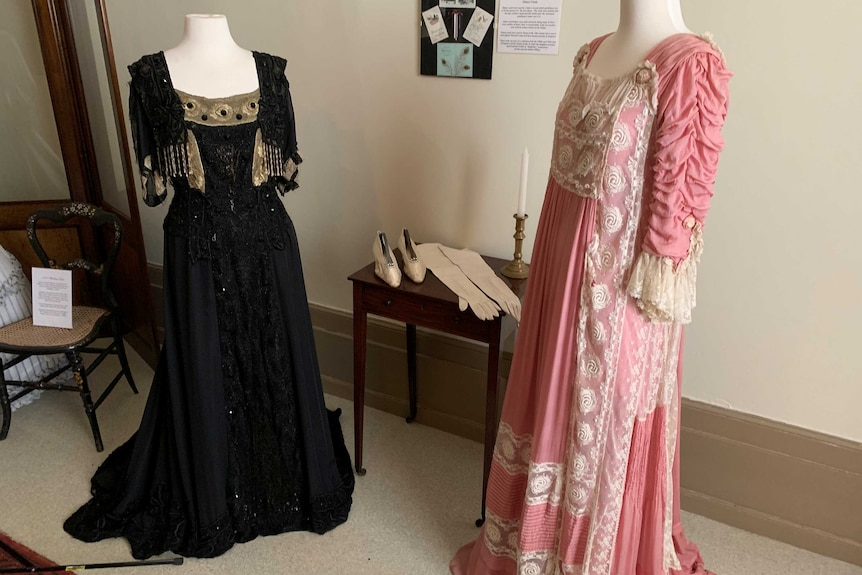 Two historic gowns on mannequins.