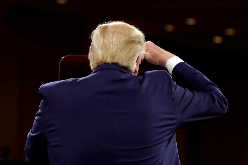 US President Donald Trump looks at the audience