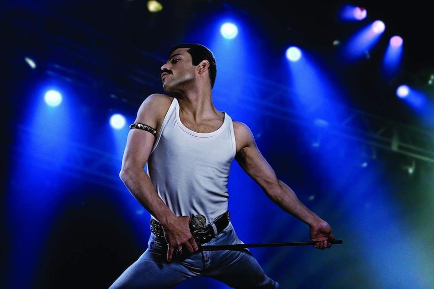 A still from the 2018 Freddie Mercury Biopic Bohemian Rhapsody showing Freddie posed on stage