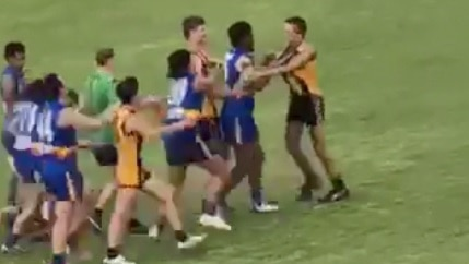 A group of young footballers get into a punch on during a game