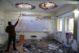 A Kabul University room pock marked by bullet holes.