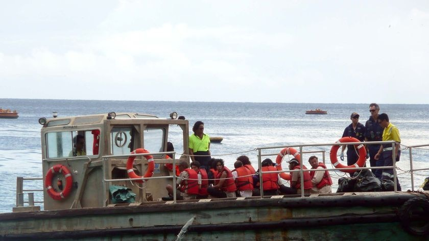 A boatload of asylum seekers heads to dock at Christmas Island on April 16, 2010.