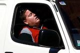 Man takes nap in van