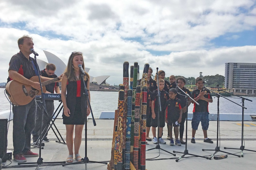 The Mount Druitt Indigenous Choir perform at the Australia Day launch in Circular Quay.