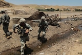 US Paratroopers run from mine-hit truck