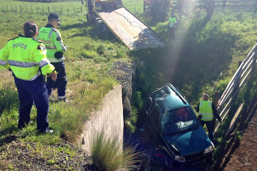 A woman died when her car careered off the Bass Highway near Penguin.