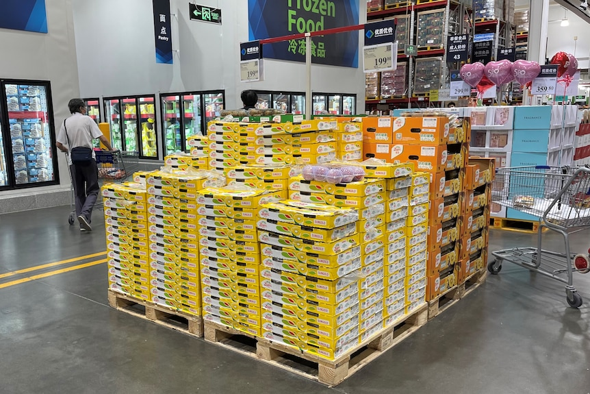 A stack of SunGold cartons on a supermarket floor.