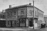 Black and white photo of old sandstone hotel in Hobart