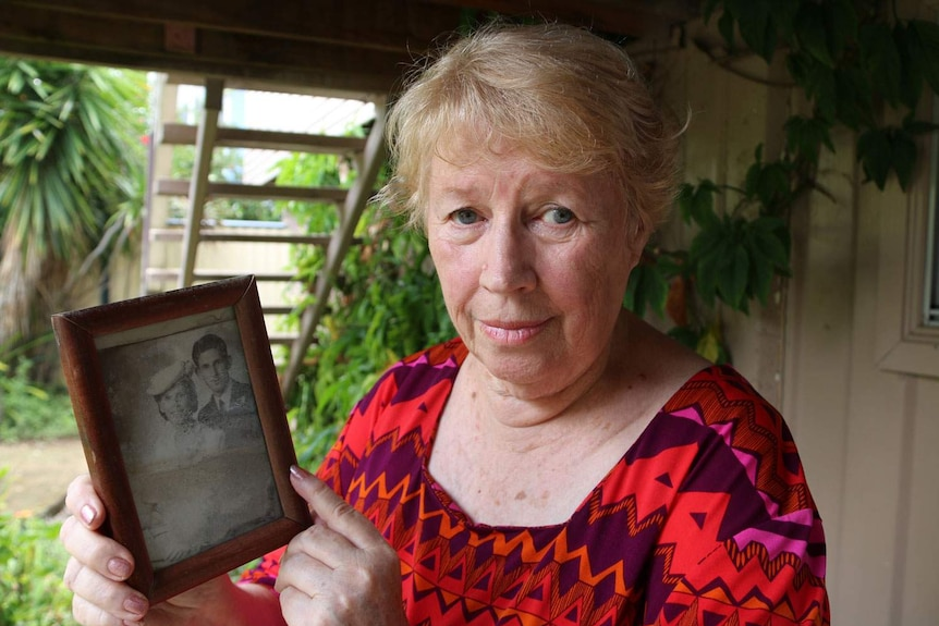 Margaret Kloostra holds a photo of her parents on their wedding day at her house at Goodna.