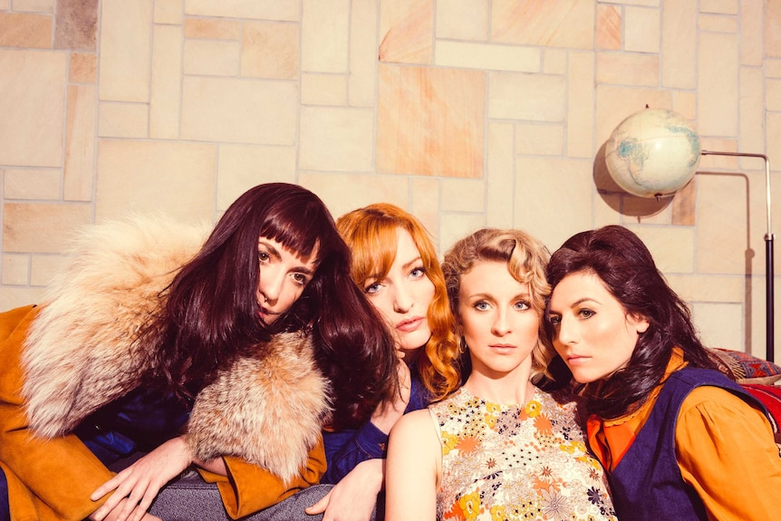 Four women from the band All Our Exes Live In Texas sit together.