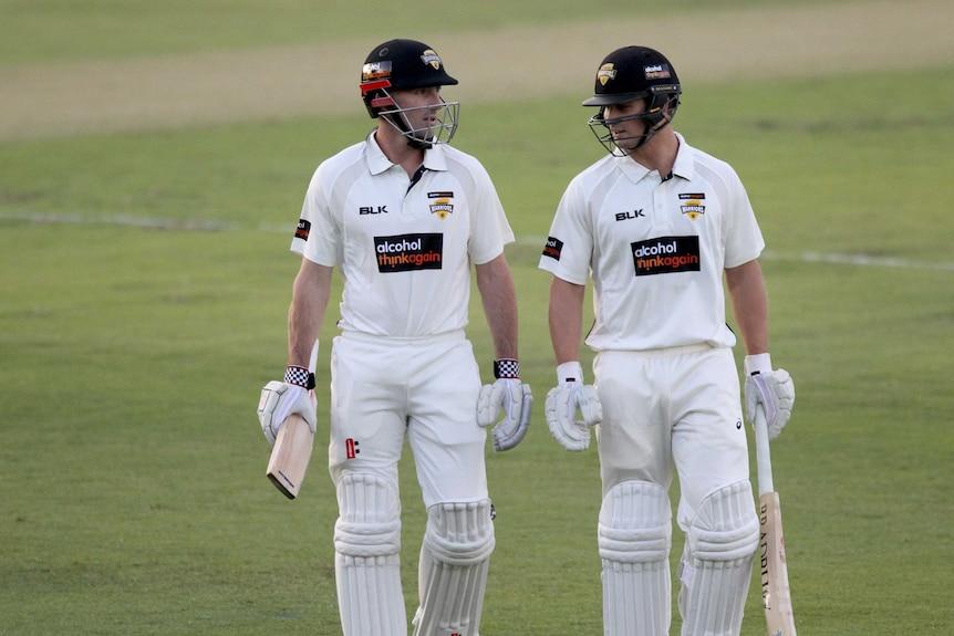 Western Australian batsmen Shaun Marsh and Hilton Cartwright leave the field.