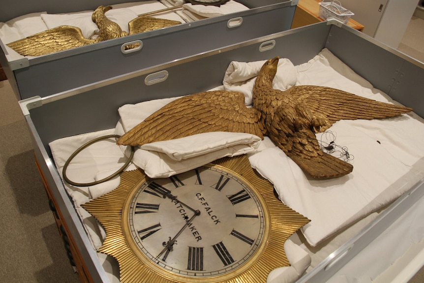 Two clocks and golden eagle sculptures made by Charles Falck in two boxes after they were delivered.