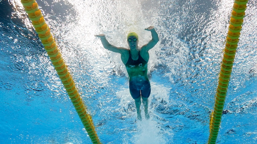 An Australian female swimmer competes in the 100 metres butterfly at the Tokyo Olympics.