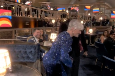 Glenn Close dancing in a sparkly blue dress at the 2021 Oscars ceremony.