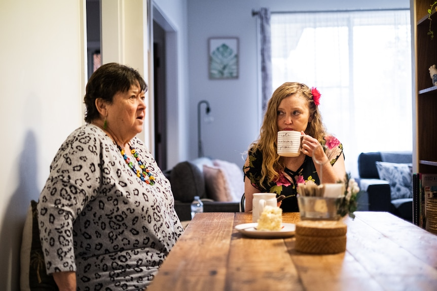 Amy Whitby and her mother Theresa Clare sitting at their dining room table.