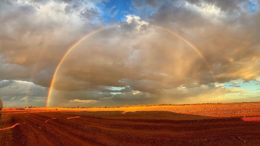 A rainbow over the Donohoe Highway, outside of Boulia, near the border in western Queensland.