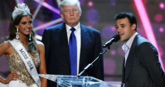 Donald Trump stands with the miss usa contenstant of the miss universe pageant.