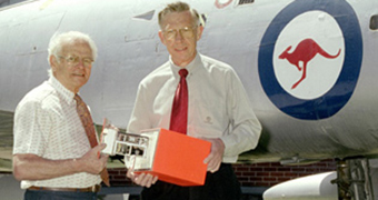 Dave Warren (left) and Ken Fraser with a black box flight recorder prototype.