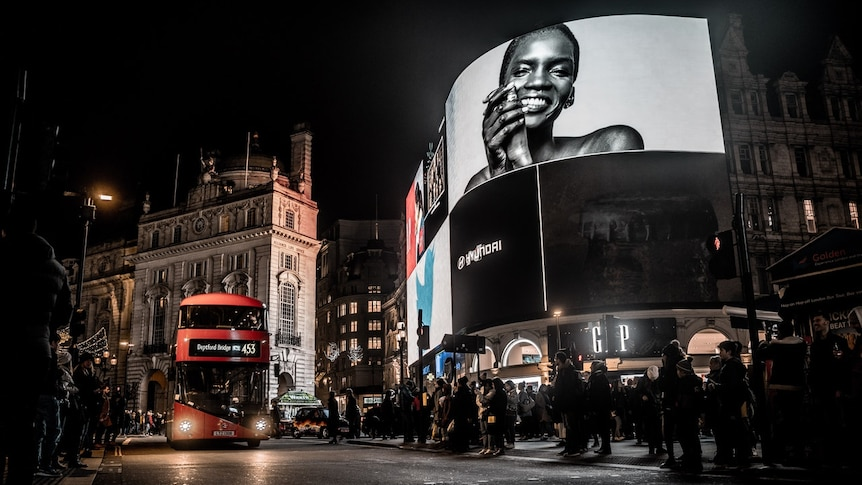 Play Audio. At night, you look up to large screens in London's Piccadilly Circus with a modern red double-decker pass driving towards you.. Duration: 18 minutes 44 seconds