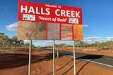'Welcome to Halls Creek' sign.