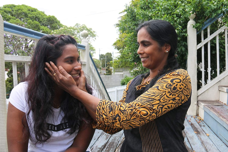 Soumiga Gopalakrishnan, with her mother Jeevarani Gopalakrishnan, on the front stairs at the home they have been staying in.