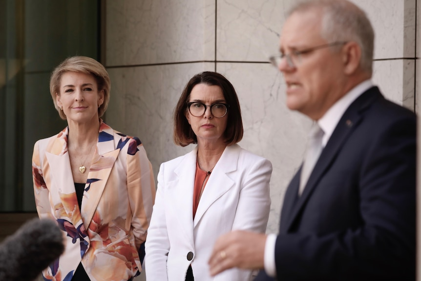Michaelia Cash and Anne Ruston looks on as Scott Morrison speaks at a press conference