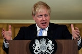 Boris Johnson gestures with his hands