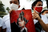 Myanmarcitizens hold up a picture of leader Aung San Suu Kyi after the military seized power in a coup in Myanmar.