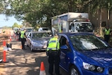 NT Police check vehicle registration and do breath testing on McMillans Road in Darwin October 8, 2014.