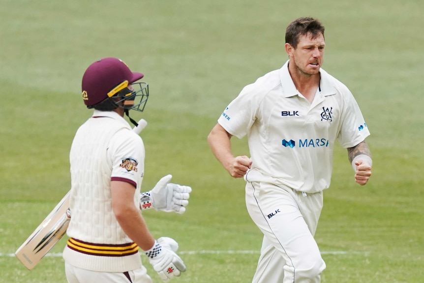 James Pattinson clenches his fists and runs past a batsman
