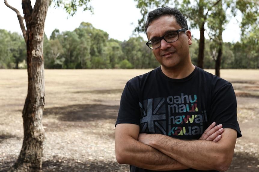 Author Greg de Moore pictured in a park in Parramatta in Sydney.