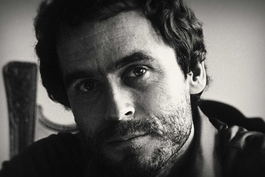 A black and white portrait of American serial killer Ted Bundy.