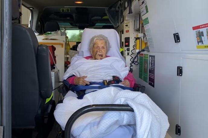 An elderly woman inside an ambulance