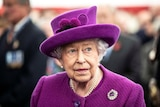 Britain's Queen Elizabeth II wearing a pink costum and hat.
