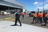 Police clear cordoned off area at Adelaide Airport