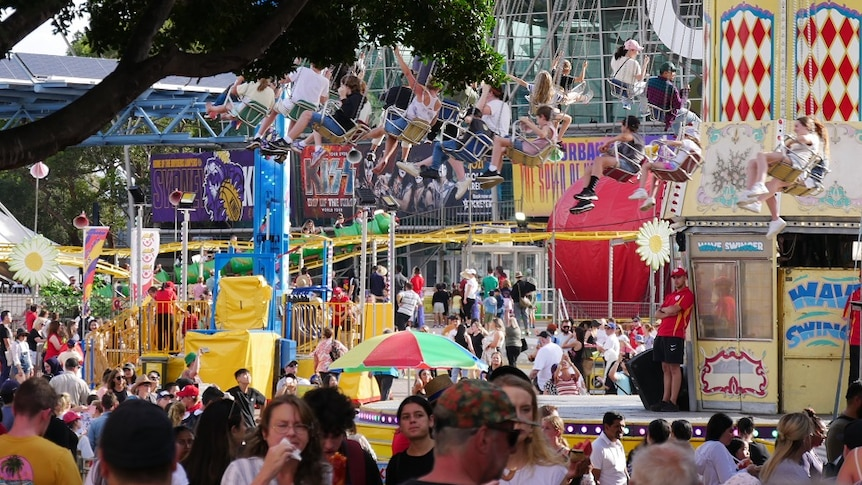 a wide shot of people and rides in sideshow alley