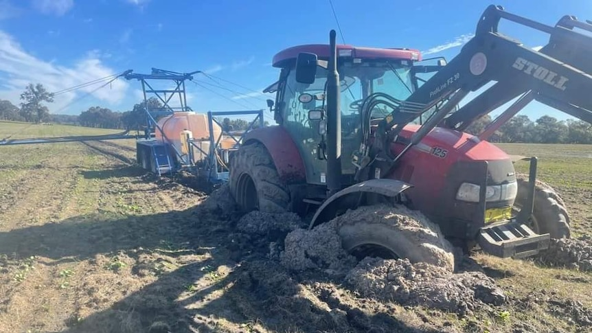 a tractor bogged in a paddock