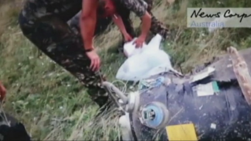 MH17 footage shows rebels rifling through luggage