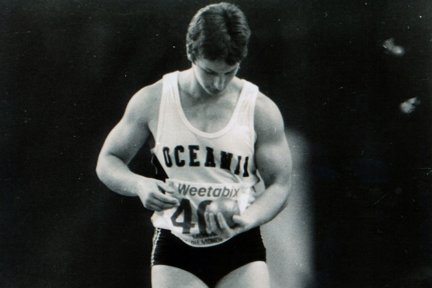 Bev as a young woman, about to throw a shot put.