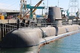 Collins class submarine HMAS Farncomb sits at the ASC shipyard in Adelaide.