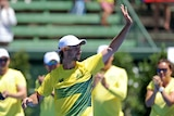 Australia's Jordan Thompson waves to fans after his Davis Cup win over Czech Jiri Vesely at Kooyong.
