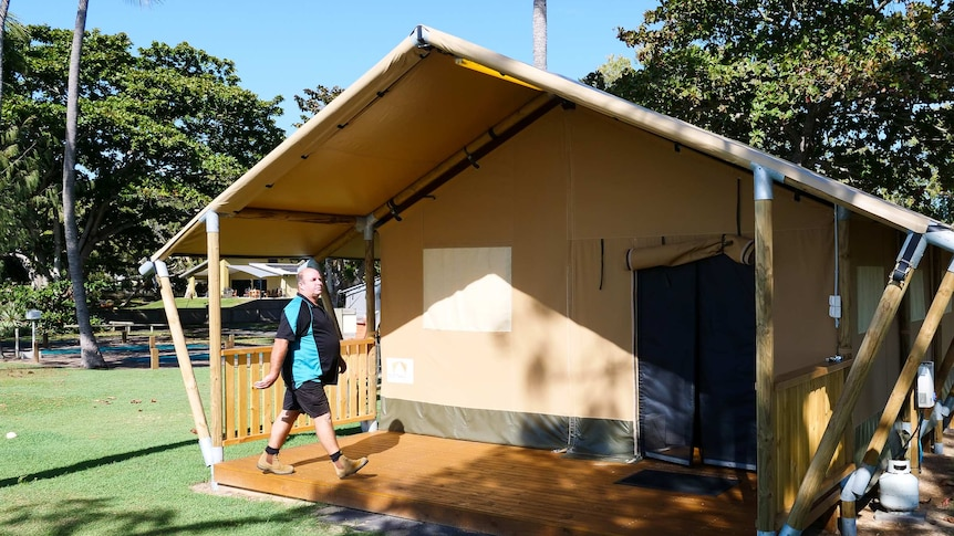 Man walks into a deluxe tent