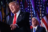 Vice-president-elect Mike Pence watches as president-electDonaldTrumpspeaks during an election night rally