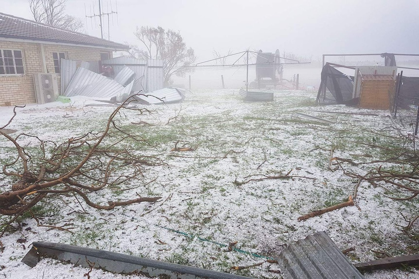 Hail on ground and debris at home after wild storm at Riverleigh, south-west of Bundaberg.
