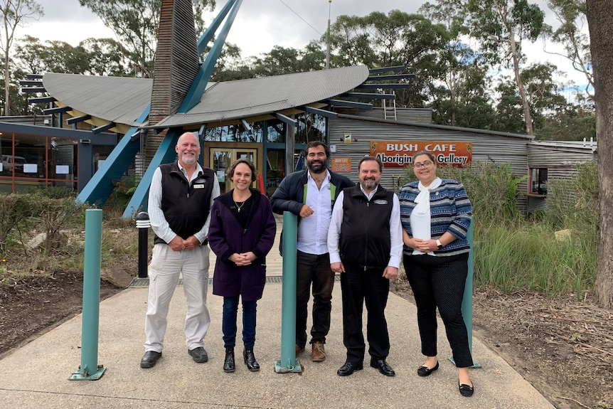 Three men and two women standing outside a cafe in East Gippsland