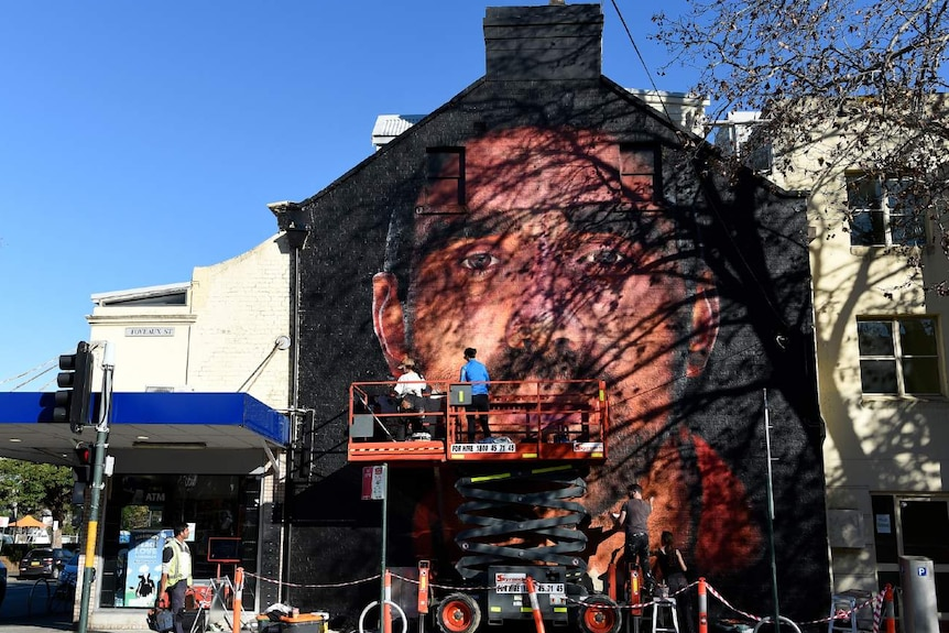 A mural on the side of a building
