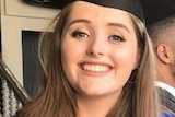 Grace Millane wearing graduation robes and smiling.