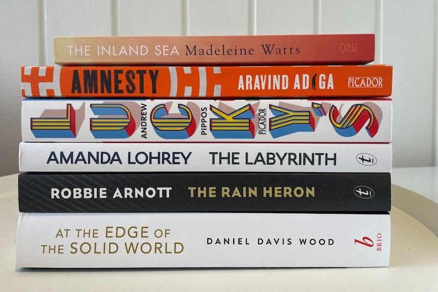 A stack of six books on the shortlist of the Miles Franklin Literary Award