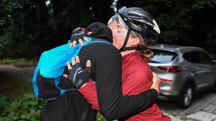Fiona Kolbinger hugs a cyclist after winning the Transcontinental Race