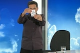 Dynamo the magician performs a trick on News Breakfast.